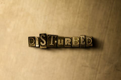 DISTURBED - close-up of grungy vintage typeset word on metal backdrop. Royalty free stock illustration.  Can be used for online banner ads and direct mail Royalty Free Stock Photo