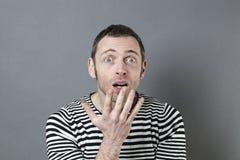 Disturbed 40s man acting surprised Stock Photo