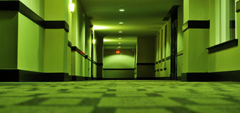 Disturbing hotel hallway. A view of a disturbing hotel hallway Royalty Free Stock Photo