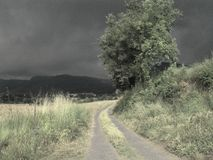 Disturbing landscape. Typical of a nightmare. Omen of storm around the road Stock Photography