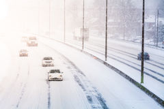 Disturbing Sunset Light and Snowstorm on Highway Stock Photos
