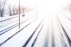 Disturbing Sunset Light and Snowstorm on Highway Royalty Free Stock Photography