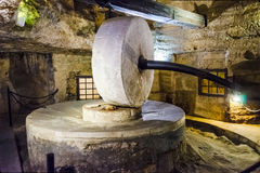 Disused ancient underground oil mill in Gallipoli, Italy Stock Photos