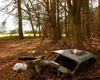 Disused Car dumped in woodland royalty free stock images
