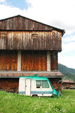 Disused Caravan and Wooden Agricultural Building Stock Photo