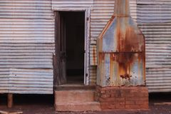 Disused cooking quarters on a station. Disused cooking quarters on a sheep station in regional Western Australia. Corrugated iron and rusted Royalty Free Stock Image