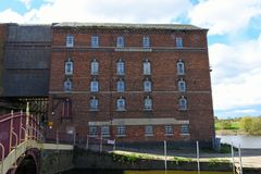 Disused Healing`s Flour Mill, Tewkesbury, Gloucestershire, UK. Healing`s or Borough Flour Mill, Tewkesbury, Gloucestershire, UK was built in 1865 on the banks of Stock Images