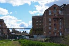 Disused Healing`s Flour Mill, Tewkesbury, Gloucestershire, UK. Healing`s or Borough Flour Mill, Tewkesbury, Gloucestershire, UK was built in 1865 on the banks of Stock Photo