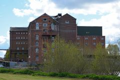 Disused Healing`s Flour Mill, Tewkesbury, Gloucestershire, UK. Healing`s or Borough Flour Mill, Tewkesbury, Gloucestershire, UK was built in 1865 on the banks of Stock Image