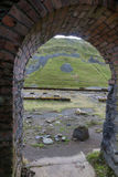 Disused lead mining area Cwmystwyth, through arch of ruined buil Royalty Free Stock Photos