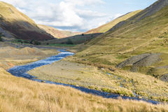 Disused lead mining area and grassy valley, Cwmystwyth, Wales Stock Images