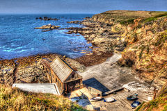Disused lifeboat station house Lizard Point Cornwall UK South West England in unique HDR like painting Royalty Free Stock Photo