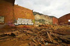 Disused old factory. Graffiti in old disused factory hall. Roof ist destroyed royalty free stock image