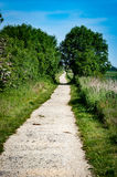Disused railway line. Disused and abandoned railway line now used as a public footpath and cycle track through the countryside Royalty Free Stock Photography