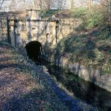 Scenic Cotswolds - disused canal. The disused Thames & Severn Canal in winter ice near the tunnel entrance at Coates, Gloucestershire, UK Stock Photo