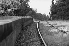 Disused Train Platform. An old train platform and train tracks that get occasional use for train museum run days Royalty Free Stock Images