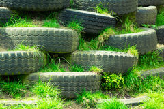 Disused tyres. Climbing wall of old disused tyres in an outdoor children playground Royalty Free Stock Images