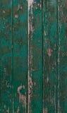 Oude groene verftextuur op een houten deur Stock Foto