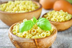 Ditalini macaroni. Pasta rings. Tubettini and thimbles. Anellini. Stock Images