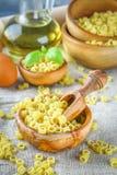 Ditalini macaroni. Pasta rings. Tubettini and thimbles. Anellini. Stock Photography