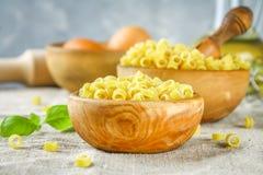 Ditalini macaroni. Pasta rings. Tubettini and thimbles. Anellini. Stock Image