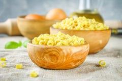 Ditalini macaroni. Pasta rings. Tubettini and thimbles. Anellini. Stock Photos