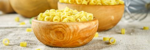 Ditalini macaroni. Pasta rings. Tubettini and thimbles. Anellini. Royalty Free Stock Images
