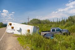 In the Ditch. A truck and trailer hit the ditch in the Yukon Territories, Canada royalty free stock image
