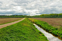 Ditch on the field. Ditch on the field in a spring time Royalty Free Stock Images