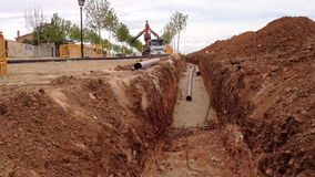 Ditch and pipes in construction site stock video