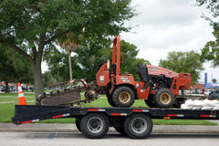 A ditch witch being transported stock photo