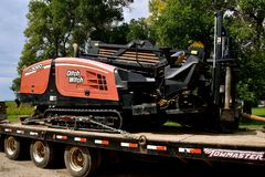 Ditch Witch Trencher loader on a flat bed trailer stock photos