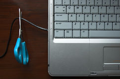 Ditch your desk!. Puling wire out of laptop to go wireless Royalty Free Stock Photos