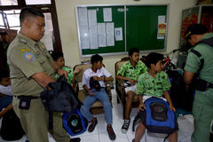 Ditching school. City government officers arrest students who skipped school in the city of Solo, Central Java, Indonesia Royalty Free Stock Photos