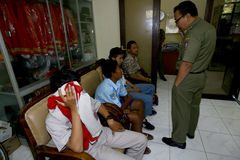 Ditching school. City government officers arrest students who skipped school in the city of Solo, Central Java, Indonesia Royalty Free Stock Images