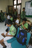 Ditching school. City government officers arrest students who skipped school in the city of Solo, Central Java, Indonesia Stock Photography