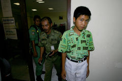 Ditching school. City government officers arrest students who skipped school in the city of Solo, Central Java, Indonesia Royalty Free Stock Photography