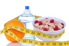 Diätgewichtverlust-Nahrungsmittelfrühstück-Bandmaß Stockbilder