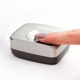 Dito su uno scanner biometrico Fotografia Stock Libera da Diritti