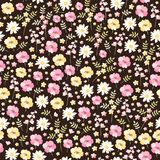 Ditsy floral seamless pattern in vector. Cute little flowers in pink, yellow and white colors on dark background.  royalty free illustration