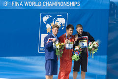 DIV: Final 3m men's diving competition. Jul 23 2009; Rome Italy; Troy Dumais (USA) silver medal winner (left) Chong He (CHN) gold medal winner (centre) and Stock Image
