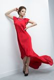 Diva. Vertical portrait of a diva posing in a fluttering red dress stock images