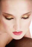 Diva. Close-up portrait of beautiful woman with professional makeup in golden colours Royalty Free Stock Photos