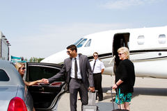 Diva arrives at private jet. In limo with chauffeur Royalty Free Stock Photo