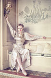 Diva. Attractive blonde woman with ballet shoes in an old house Stock Photo
