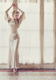 Diva. Attractive blonde woman dancing ballet in an old house Royalty Free Stock Images