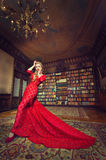 Diva. Attractive blonde woman in a long elegant red dress Stock Photos