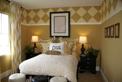 Diva Bedroom. Cute Designer Diva Bedroom with stylish decor diamond paint pattern on wall in brown and tan colors royalty free stock images