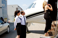 Diva enters plane. Diva lady enters private jet Royalty Free Stock Image