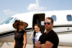 Diva exits plane with guard present. Lady Diva exit plans with guard and stewardess in attendance Royalty Free Stock Photo